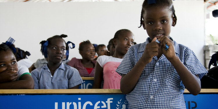 A student poses for a photo after the inauguration of the Celie Lilavois school in Port au Prince. The school buildings were destroyed in the quake and UNICEF's construction unit rebuilt it in time for October the 4th, date that marks the beginning of the school season.
