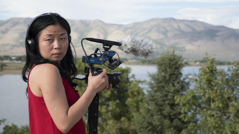Nanfu Wang filming on location