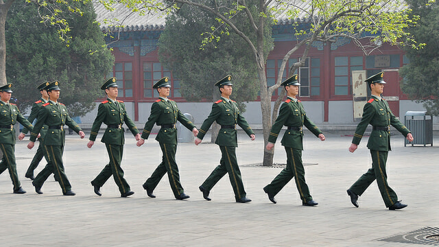 Chinese soldiers at Tiananmen square. The PLA has regularly infiltrated Western servers since 2001. Photo courtesy of Peter M. via Flickr.