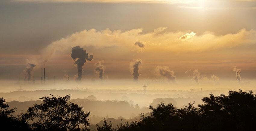 industry-sunrise-clouds-fog-impakter-trump