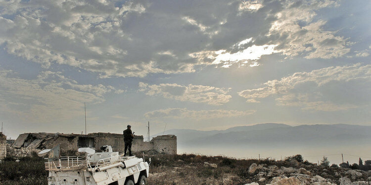 Military personnel of the United Nations Interim Force in Lebanon (UNIFIL)  on patrol in an armored personnel carrier.
