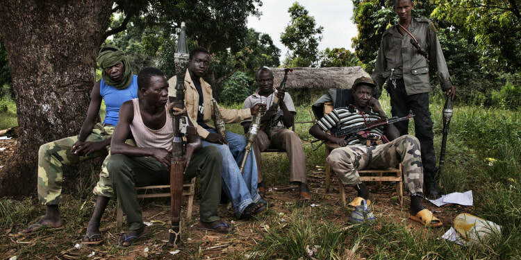 Seleka fighters at a checkpoint on the road out of Bossangoa. They regularly loot the local population as they come into town from their farms where they have been seeking food.