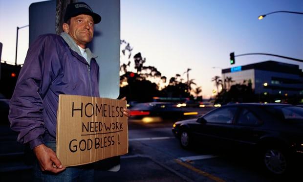 A homeless man stands on a street corner Photograph by Joel Stettenheim CORBIS