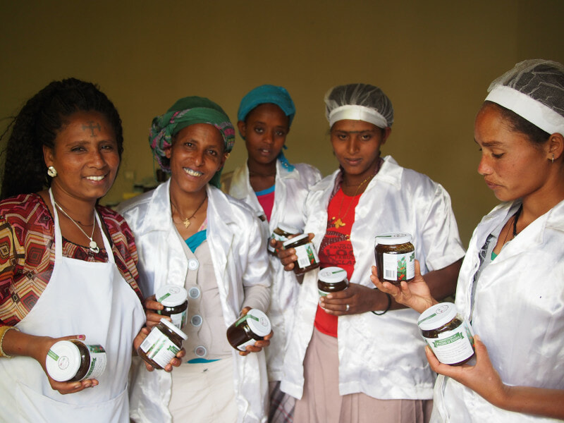 January 14 2015, Tigray, Ethiopia - Employees pose with Cactus Pear Marmelade jars at Tsega Gebrekidan Farm Cooperative. GCP/ETH/073/ITA : FAO partners with italian Gourmet Food Store Eataly to support a cooperative of Women ran by Tsega Gebrekidan Aregawi in Tygray, Ethiopia. The mission is part of a global project to support family farmers around the globe in boosting their production and finding ways to reach new overseas customers.