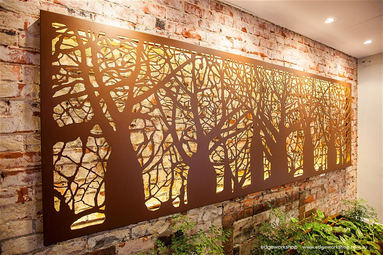 tree cut out breaking up wall lighting