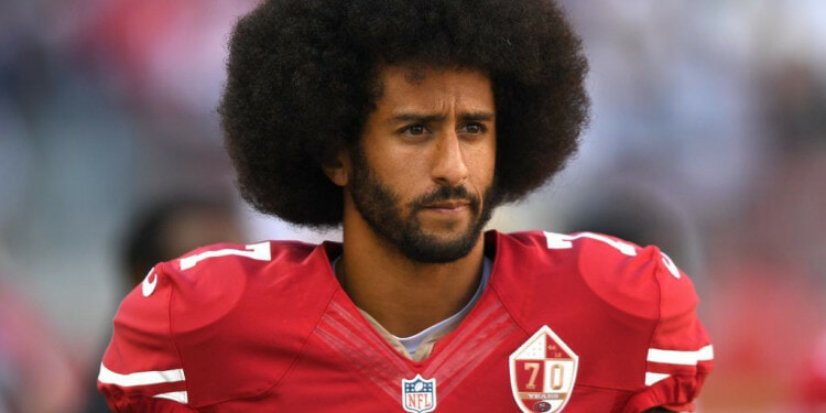 SANTA CLARA, CA - OCTOBER 02:  Colin Kaepernick #7 of the San Francisco 49ers looks on from the sidelines against the Dallas Cowboys during the second half of their NFL football game at Levi's Stadium on October 2, 2016 in Santa Clara, California.  (Photo by Thearon W. Henderson/Getty Images)