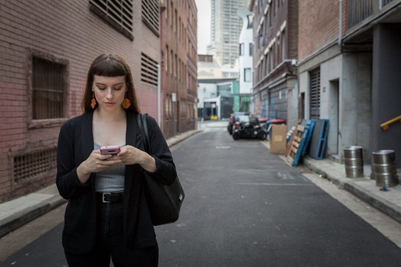 A young woman in Sydney uses the Free to Be app to drop a pin
