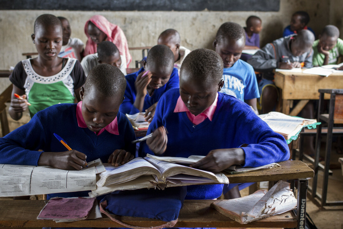 Students Abigail (R) and Purity (L) in class at Kongolai Primary School
