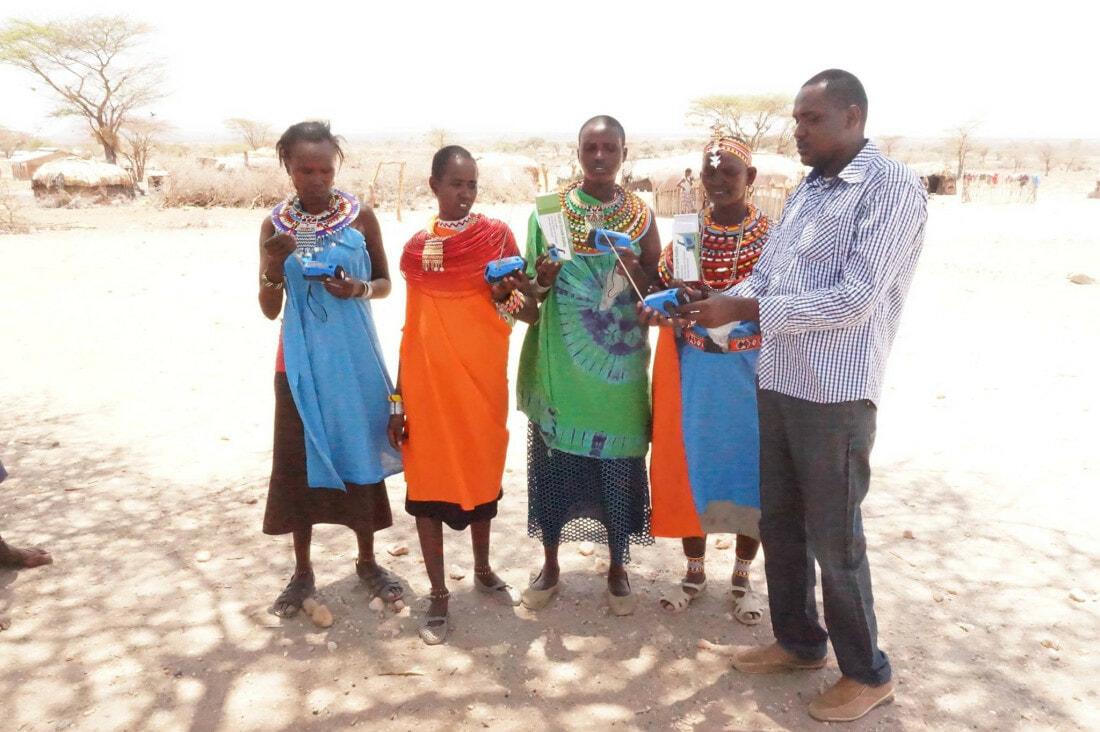 Samuel Leadismo with Samburu girls in his workshop