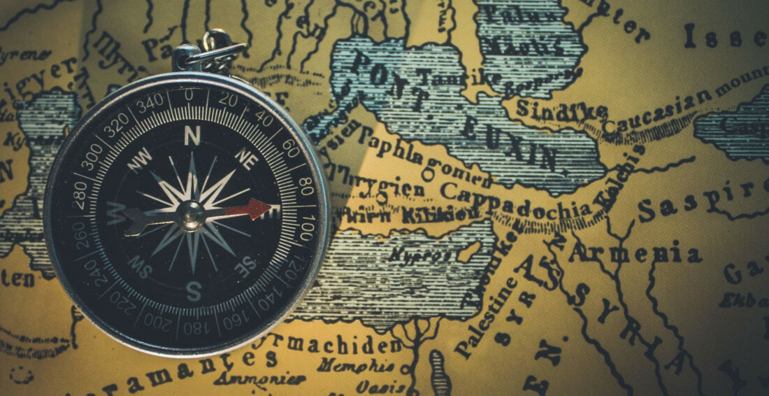 Compass and map showing borders and boundaries.