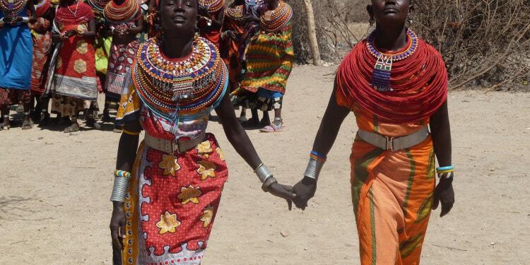 Two Kenyan women holding hands