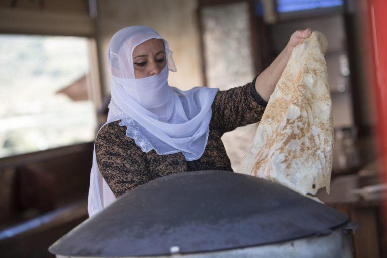 Druze woman baking