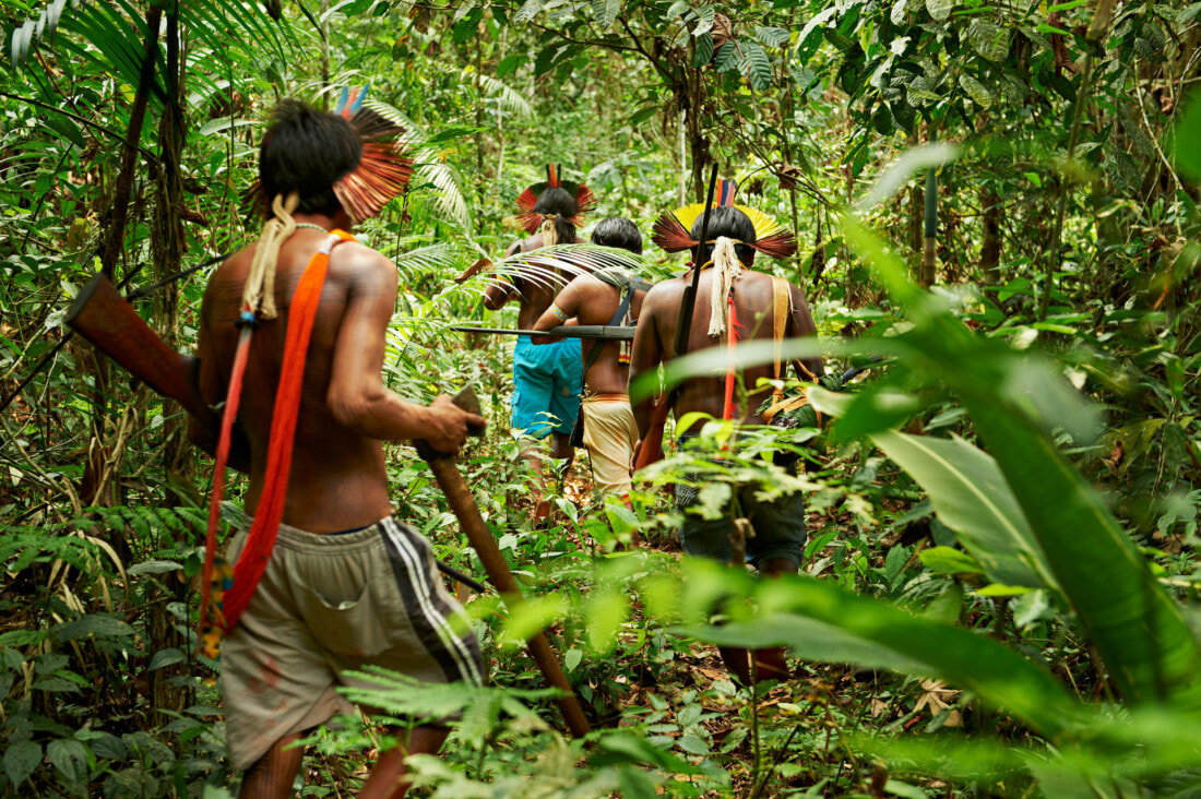 Men from Kayapo, an indigenous tribe living in the Amazon rainforest and fight against development and deforestation of the area.