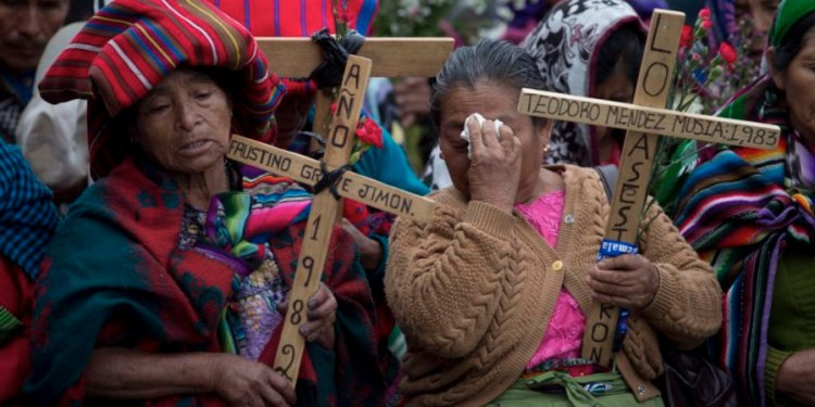 Mayan women protesting human rights crimes against their people from 1960-1996