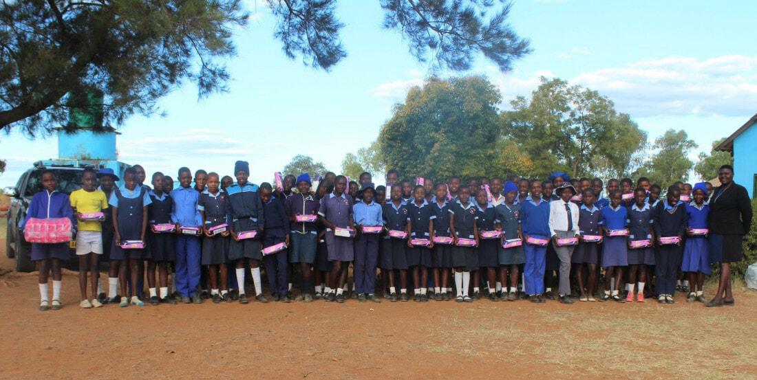 On International Hygiene Day, Shamwari Yemwanasikana donates sanitary pads to Jonasi primary school girls.