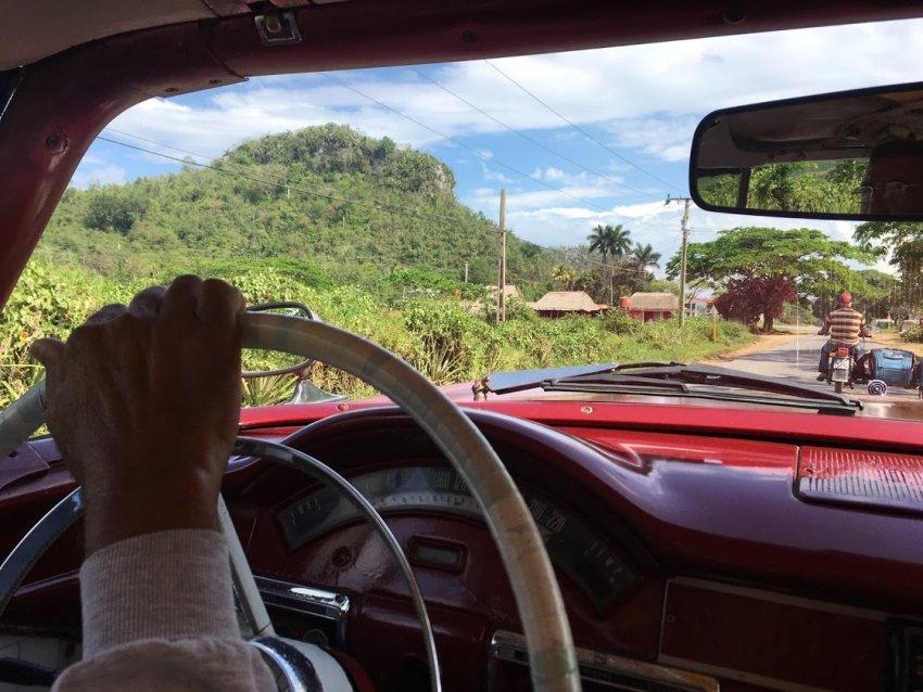 Lazaro's hand at the wheel