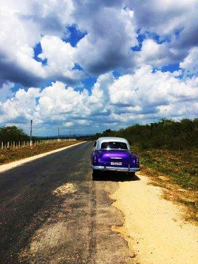 The purple vintage Chevrolet parked
