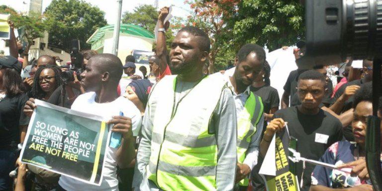 Men protesting the Abuja raid