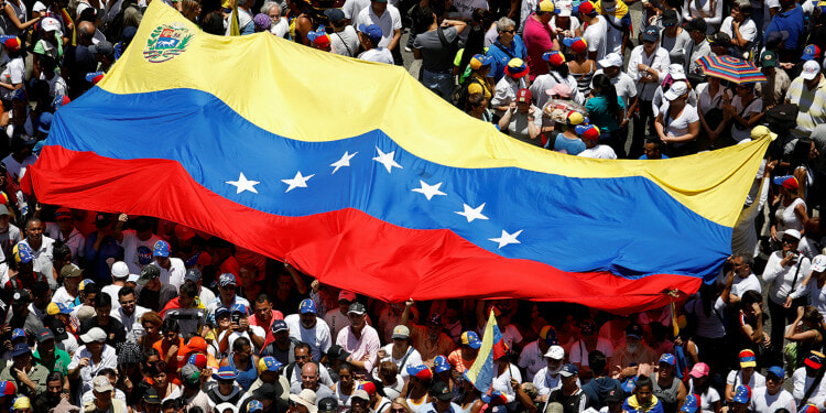 Venezuelan protest with country flag