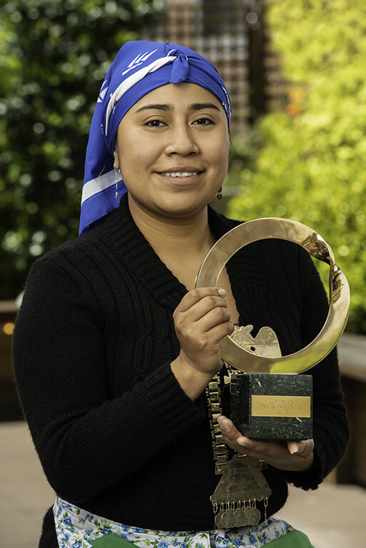 Belen Curamil Canio with the Goldman Environmental Prize she received on behalf of her father.