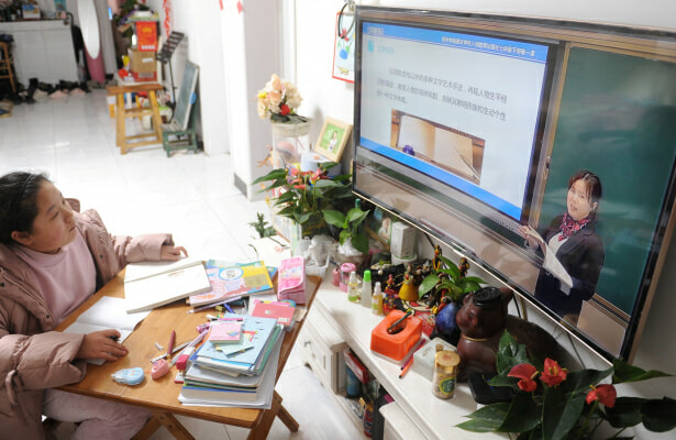 A child attends an online class in China during the COVID-19 pandemic.
