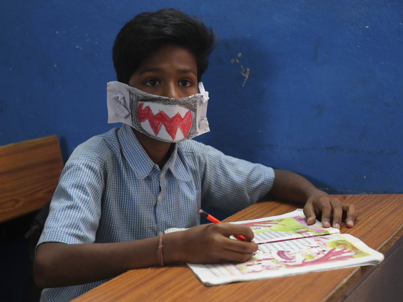 A child wears a self-made mask to class in an Indian school.
