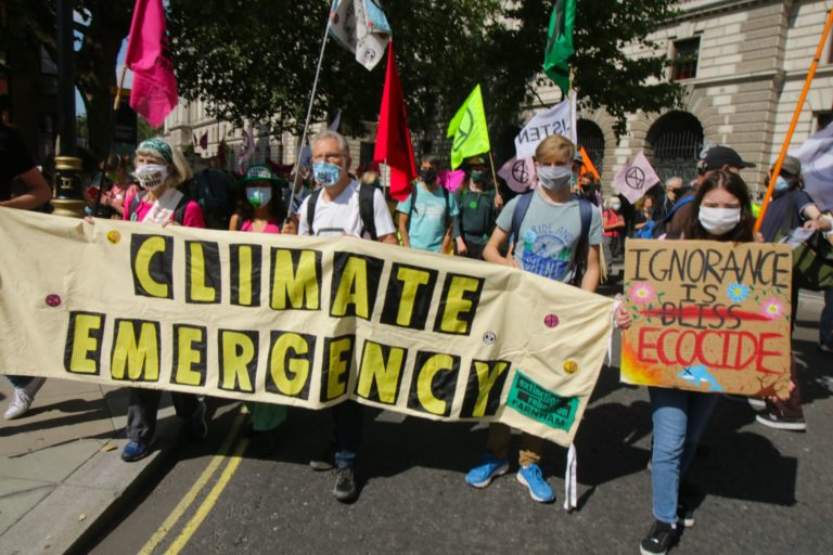 Extinction Rebellion protesters holding climate banner