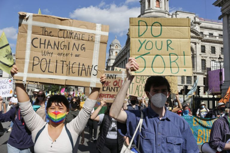 Extinction Rebellion protesters holding signs