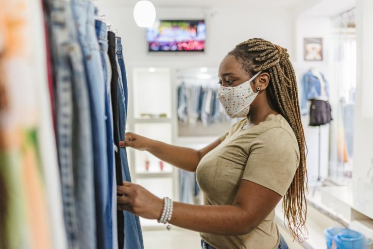 Woman clothes shopping covid