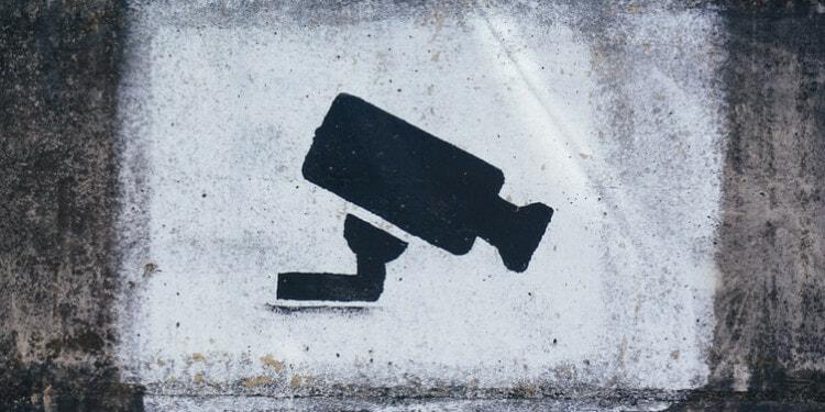 Graffiti of spy camera on wall