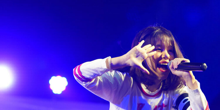 """Naruthai Tansukasem performing during a 2019 reunion concert with her former group """"Siamese Kittenz"""". Photo courtesy of Kukufoto"""