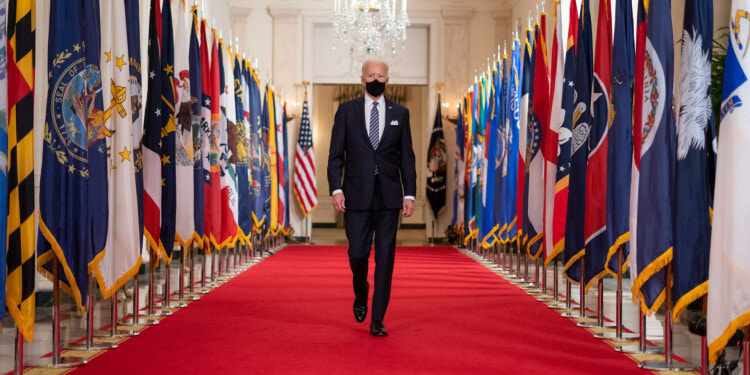 President Joe Biden walks from the State Dining Room of the White House to a podium in the Cross Hall of the White House Thursday, March 11, 2021, to deliver remarks on the one year anniversary of the COVID-19 Shutdown. (Official White House Photo by Adam Schultz)