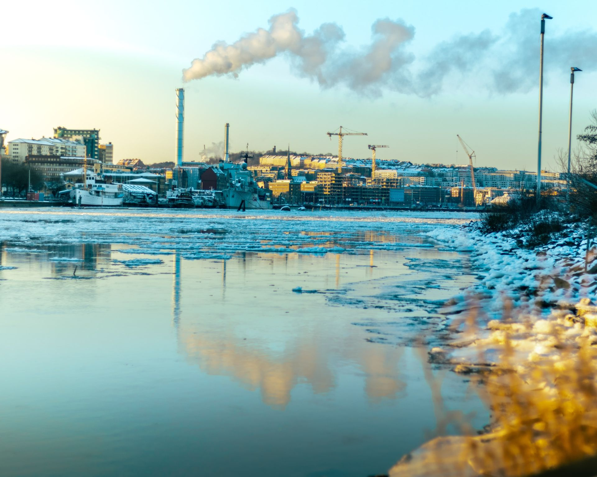 Factory polluting a nearby waterway