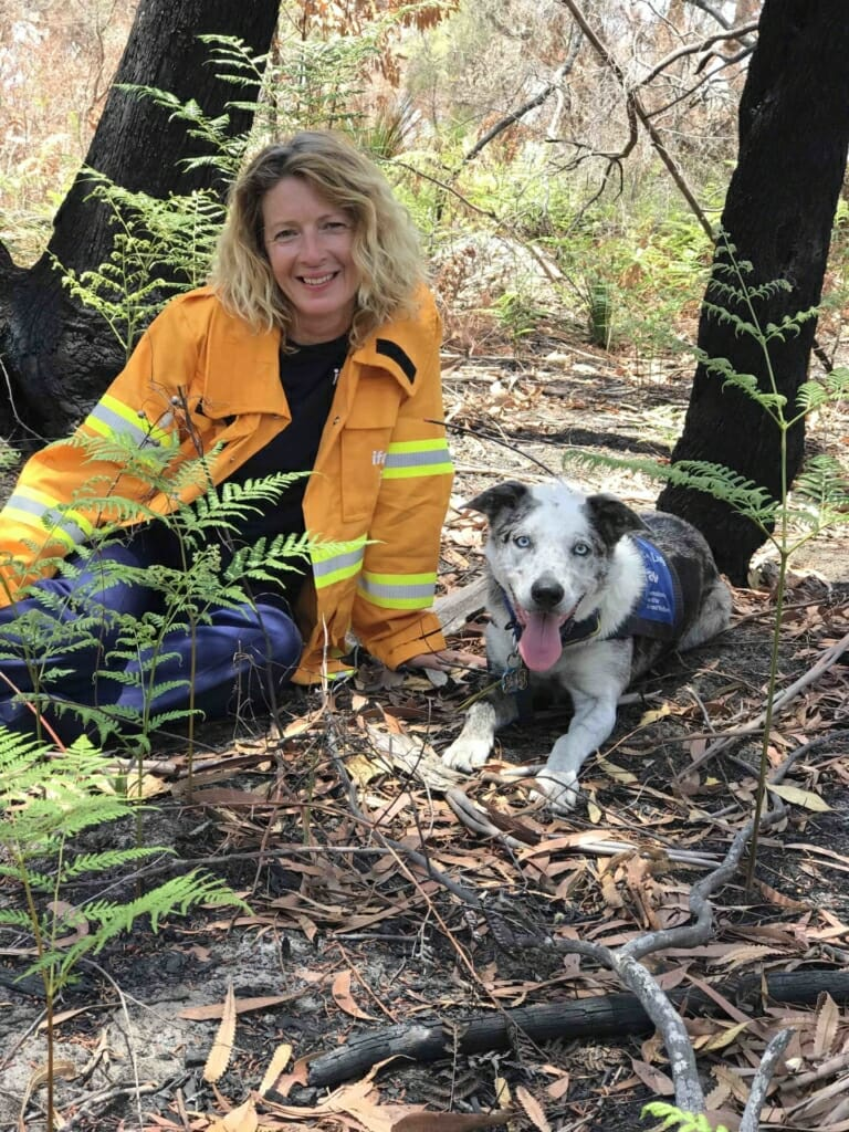 Josey Sharrad out in the wildlife with a rescue dog.