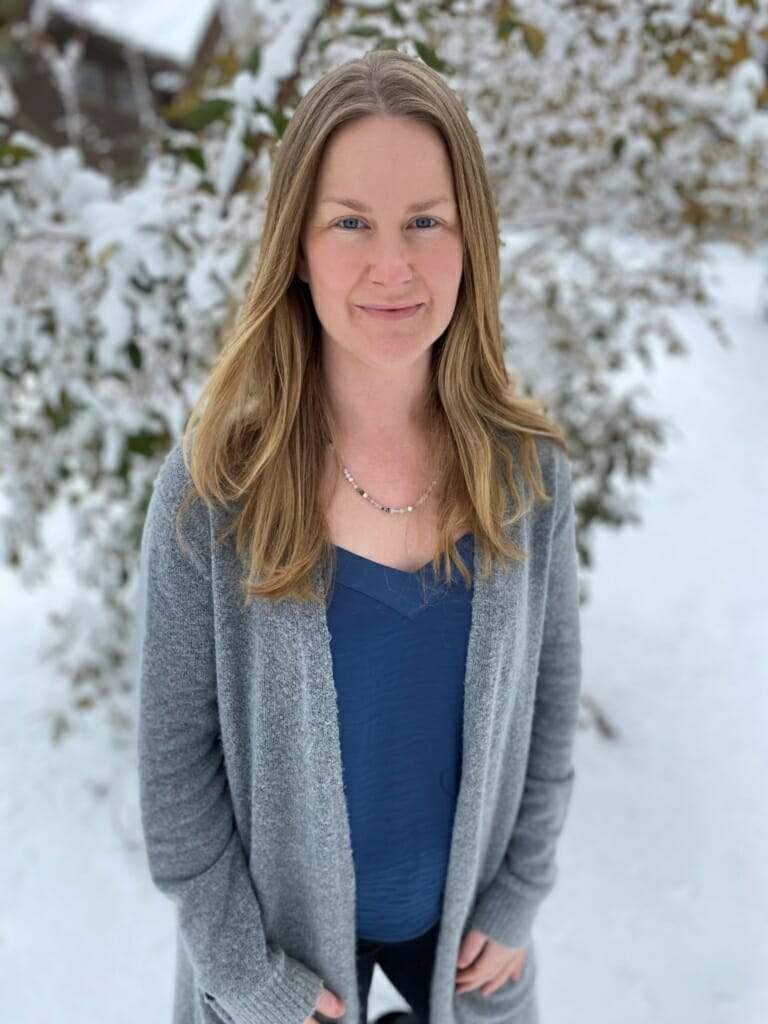Jennifer Gardner, a woman in animal conservation, standing in the snow