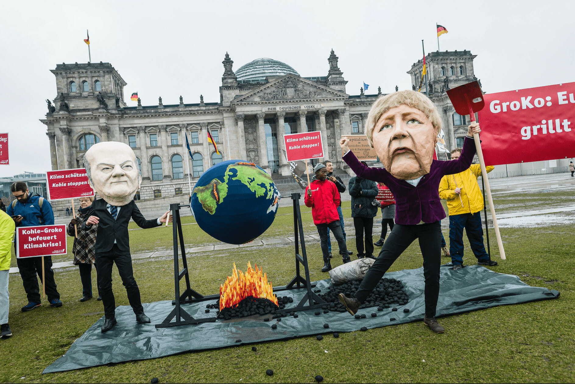 climate activists protest Angela Merkel