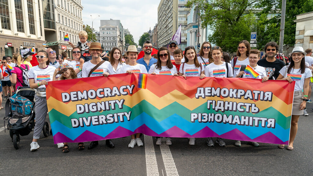 LGBTQ+ group hold sign at Pride in Ukraine