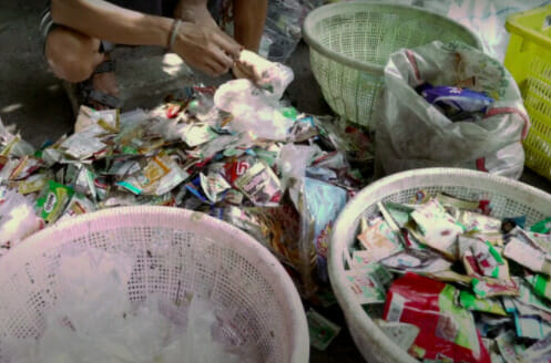 Clutter of coloured plastic sachets in Indonesia
