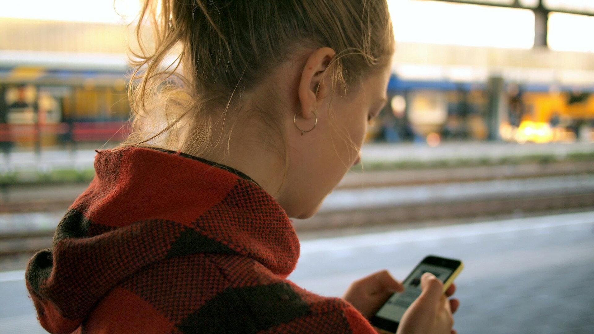 Girl using social media on phone